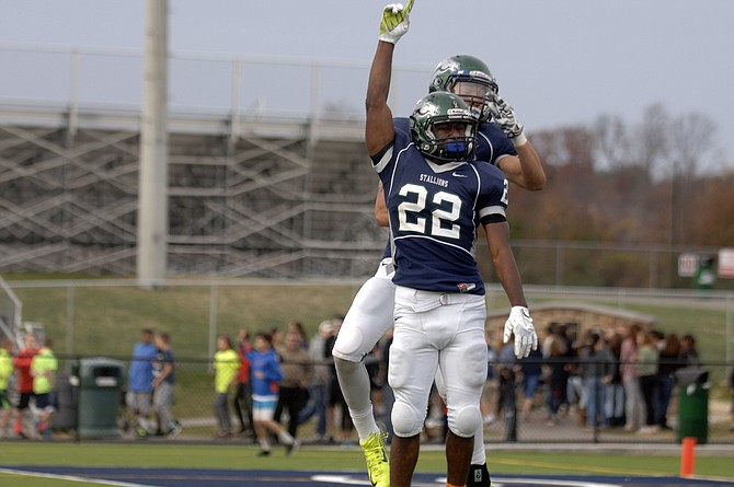 Michael Williams celebrates during South County's 20-15 win over Robinson in the 6A North semifinals on Saturday at South County High School.
