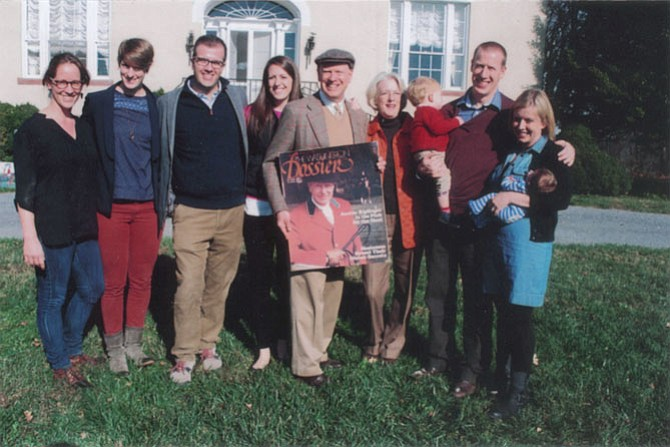 "The family of the late Austin H. ""Kip"" Kiplinger gathered at the Kiplinger River Road home, ""Montevideo,"" for the annual Potomac Hunt Thanksgiving Day meet. His son, Knight Kiplinger, holds one of  several enlarged photos that were shown commemorating the hunting days of his father. From left are: Heidi Stucker, Sutton Kiplinger, Dave Steadman, Daphne Kiplinger, Knight Kiplinger, his wife, Ann, their son Bringham holding year-old Nate, and Bringham's wife, Eliza, with 8-day-old Callan Ford Kiplinger."