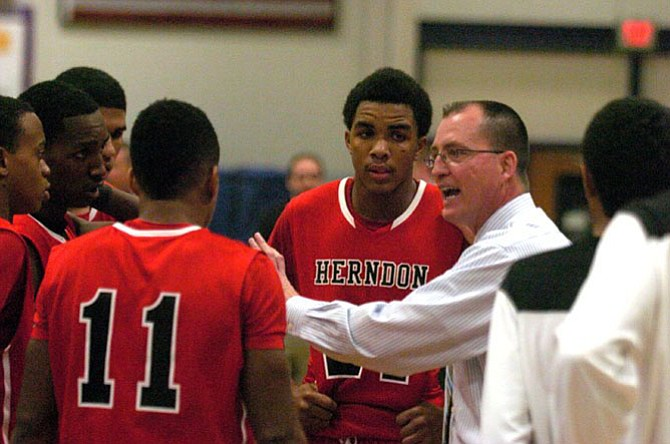 Head coach Gary Hall and the Herndon boys' basketball team in December.