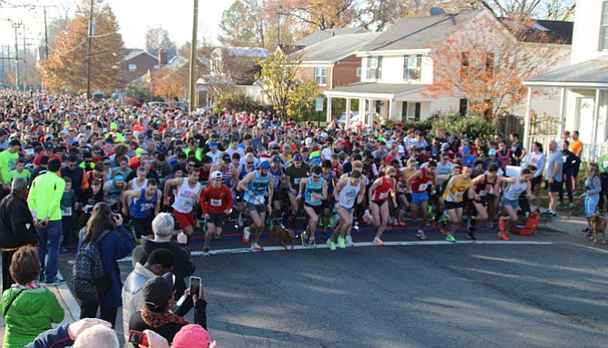 A record setting 5,700 runners lined up for the 40th anniversary of the Alexandria Turkey Trot in Del Ray. Two course records were set in the annual Thanksgiving Day race that also serves as a benefit for the ALIVE! nonprofit food bank.