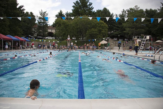 Burke swimmers participate in a Swim-A-Thon for charity during the summer season earlier in 2015.