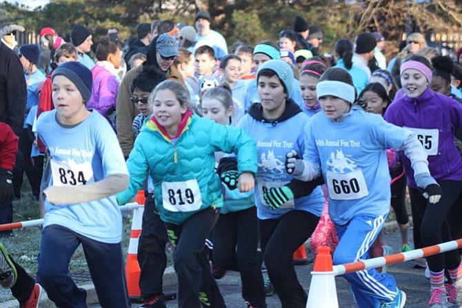 From left, sixth-graders Matthew Verich, Ella Sessine, Denali Mason, Carlye Olsen, Zoe Wallach, Clara Marshall and Sara Langdon begin the Fort Hunt Elementary School Fox Trot one-mile race.