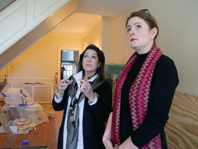 "Victoria Sanchez and Cheryl Jaeger discuss the crown moldings and chair rail in Jaeger's dining room in her historic house on S. Asaph — what is original, how married is she to keeping them? This is their first consultation. As she looks around the space, Sanchez recommends replacing the sizes of the 6-inch light fixtures with 3 inches. Jaeger says, ""I have to use Victoria because she knows how to mix up the traditional with the new, how to choose among the 5,000 shades of white."""