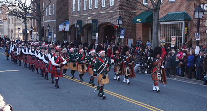 The Northern Virginia Firefighters Emerald Society Pipe Band marches up King Street for the mass bands finale of the 45th annual Scottish Christmas Walk parade Dec. 5.