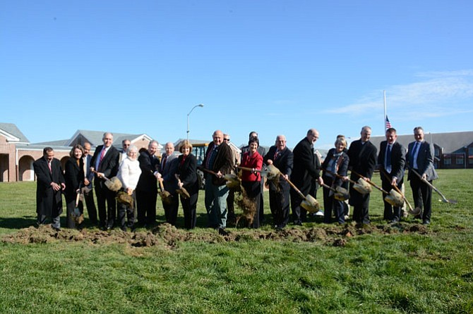 Elected officials, community leaders and other involved with the Liberty Crest at Laurel Hill redevelopment project break ground officially on Dec. 7.