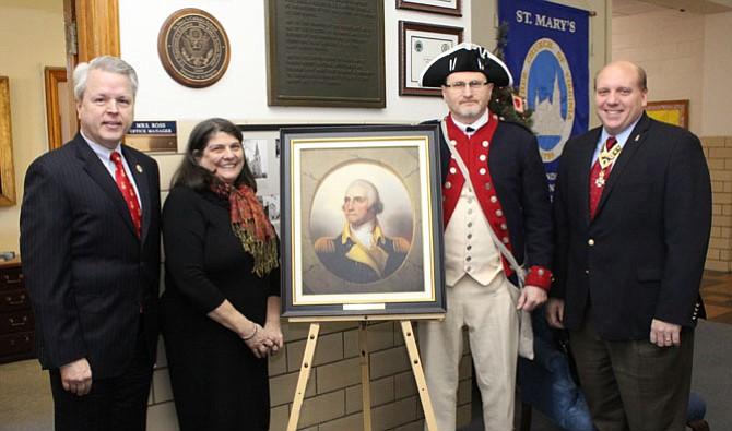 The presentation of a portrait of George Washington by the George Washington Chapter to Saint Mary's School with Joe Dooley, president general, National Society of the Sons of the American Revolution 2013-14; Janet Cantwell, Saint Mary's principal; Dwight Whitney, president, George Washington Chapter; and Mike Elston, second vice president, Virginia Society.