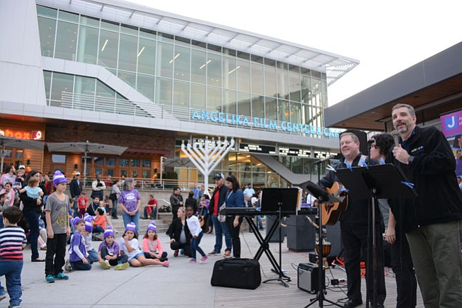Cantors from Temple Rodef Shalom in Falls Church entertain community members at the Dec. 13 menorah lighting in the Mosaic District in Fairfax.