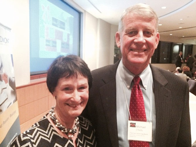 Board of Supervisors Chairman Sharon Bulova with Michael L. O'Reilly, chairman of the Governing Board, Fairfax County Office to End and Prevent Homelessness.