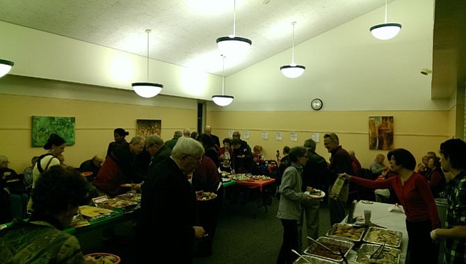 Community members sample a variety of food from local restaurants at the 2015 Taste of Braddock on Dec. 9.