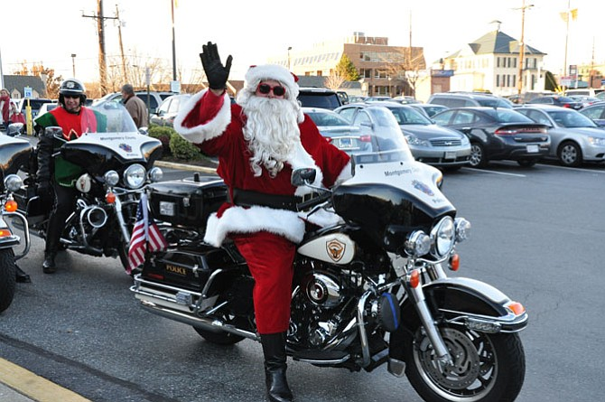 Officer Bob Ladany dresses up each year as Santa and rides his Harley throughout Montgomery County, escorted by Mrs. Claus, his elves and 40 uniformed officers. They were collecting donations for The Children's Inn at the National Institutes for Health.