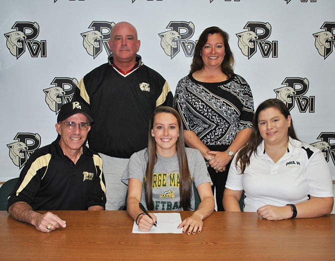Aker is pictured with her parents Mike and Jackie Aker and Paul VI softball coaches Patti Hinko and EJ Thomas.