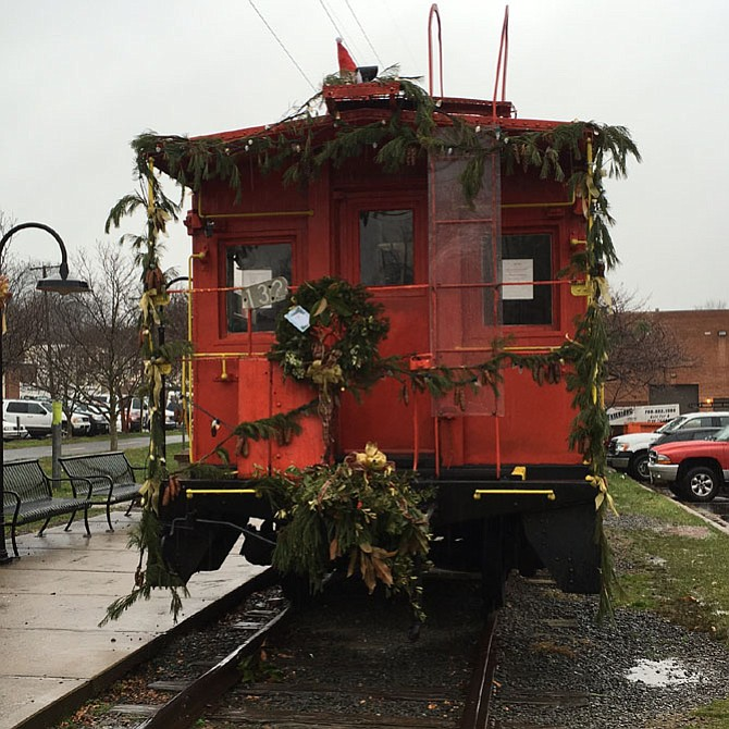 The red caboose, permanently stationed in the Historic Church Street Corridor, is decked out in festive greens crafted by the Ayr Hill Garden Club. The Optimist Club of Greater Vienna maintains the caboose.