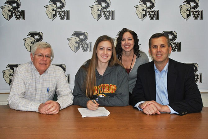 Brooke Stanley with her parents Tim and Kim Stanley and Paul VI volleyball coach Sam Farrar.
