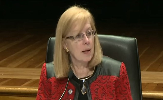Fairfax County School Board vice chairman and Mason District Representative Sandy Evans introduces the school name change policy revision at the Board's Dec. 17 meeting.