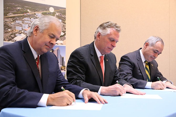 Inova CEO J. Knox Singleton (from left), Gov. Terry McAuliffe, and George Mason University president Ángel Cabrera at a news conference announcing a strategic partnership between Inova and George Mason University.