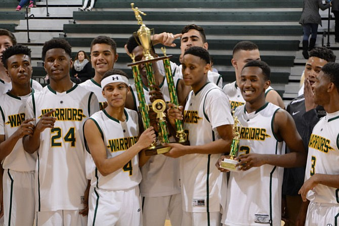 Members of the Wakefield boys' basketball team celebrate winning the George Long holiday tournament on Dec. 30.