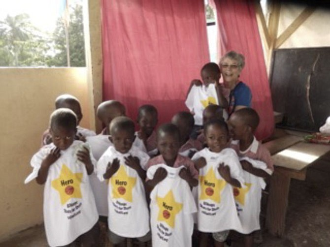 Emelie Parker of CCH and some Haitian students in their Shots for Shots T-shirts.