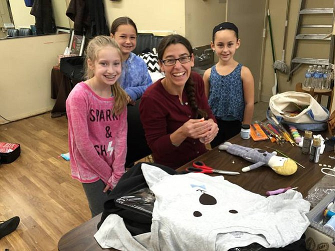 "Sharon Alexander, the ""Peter Pan"" costumer, at work with Fairies in the show, from left, Emily Ashman (Silvermist), Lexi Blank (Rosetta) and Vidia (Rachel Reinstein)."