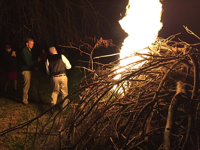 Bill Conway with son Will as the bonfire starts during the family's annual Christmas party.