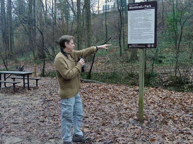 """""""Over there,"""" Tom Albright points to the Winter Wren in the undergrowth at Monticello Park. He is participating in the 116th annual Audubon Christmas Bird Count that runs from Dec. 14-Jan. 5 each year."""