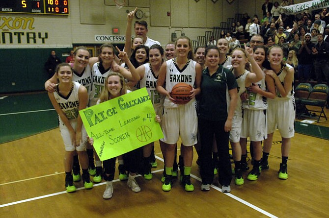 Senior guard Paige Galiani, with ball, became the Langley girls' basketball program's all-time leading scorer during a Jan. 8 game against McLean. Galiani finished with four points, giving her 1,157 for her career.