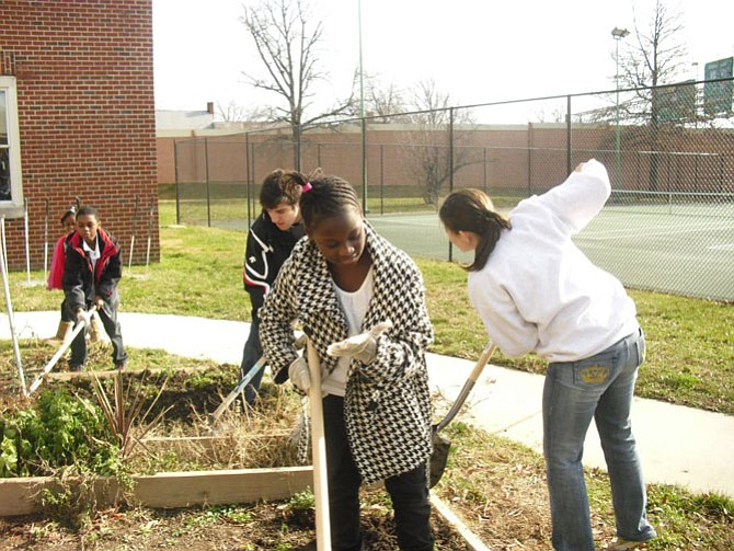 Community Garden upkeep during a previous Martin Luther King Jr. summit.