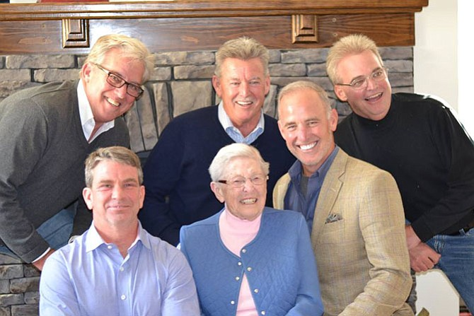 "Ruth Ann Harvey is surrounded by her ""boys,"" Michael, Jimmy, Tom, Steve and Billy."