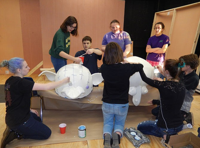 Chantilly tech students painting the giants' heads.