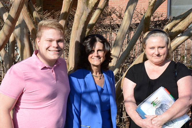 (From left) Brain Injury Services Communications coordinator Austin McNair, executive director Karen Brown and survivor Kim Daily stand outside the BIS main office in Springfield.