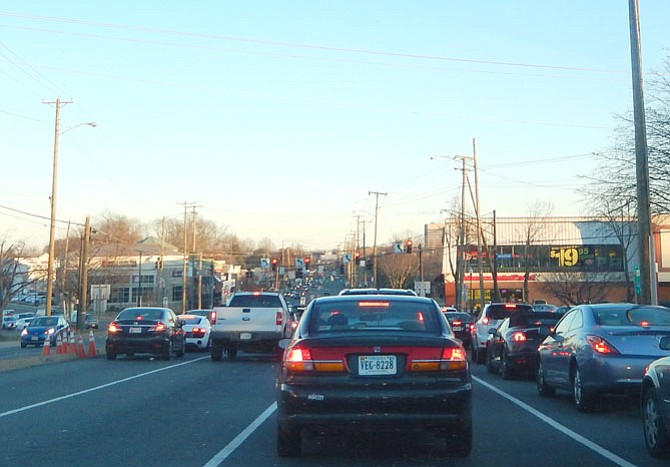 Late Monday afternoon traffic on Route 50 east heads toward the Kamp Washington intersection.