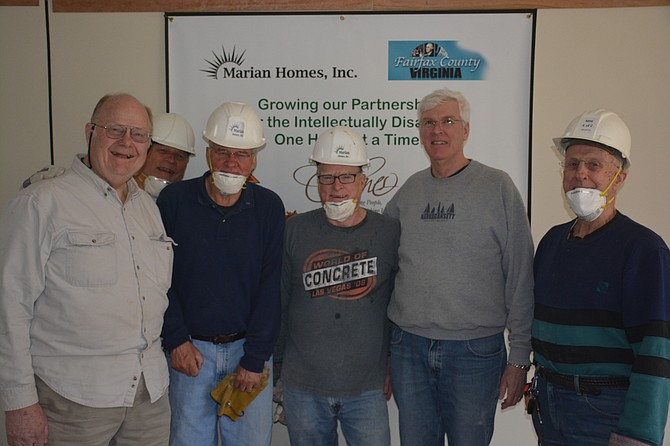 (From left) Knights of Columbus Council 8600 and Assembly 3596 members Bill Crowder, Al Obuchowski, Phil Torrey, Scott Leitch, Bill Baker and John Germain helped demo the fourth structure Marian Homes will renovate to provide housing and service for five individuals with disabilities.