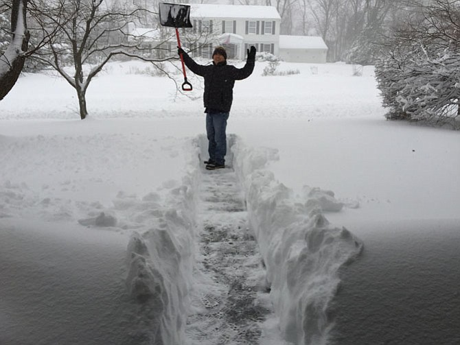 Taek Lee of Great Falls clearing the snow from this week's blizzard.