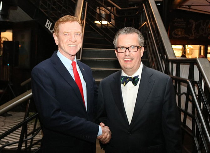 Alexandria Chamber of Commerce CEO Joe Haggerty, left, officially welcomes Grant Thornton's Robert Shea as the 2016 board chair at the Chairman's Community Reception Jan. 20 at Blackwall Hitch Restaurant.