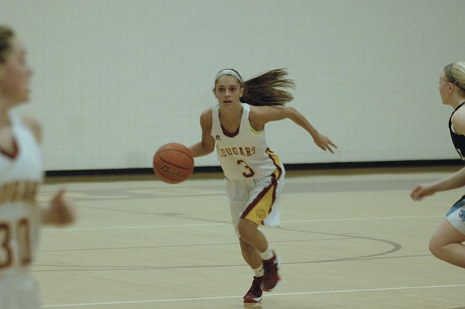 Oakton senior guard Alex Marquis scored her 1,000th career point on Feb. 1 during a 47-34 win over Centreville at Oakton High School.