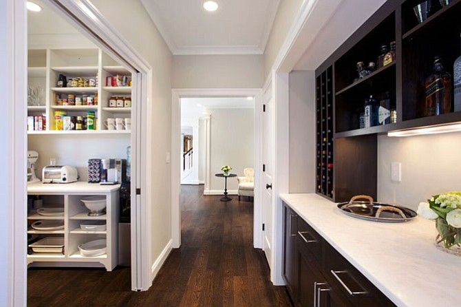 Rill Architects designed this butler's pantry in Potomac, Md., with pocket doors.