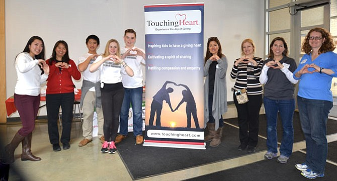 Organizers, staff and associates of Touching Heart show their signature move at the 2016 Minecraft for a Mission event to raise funds for local foster care programs and children.
