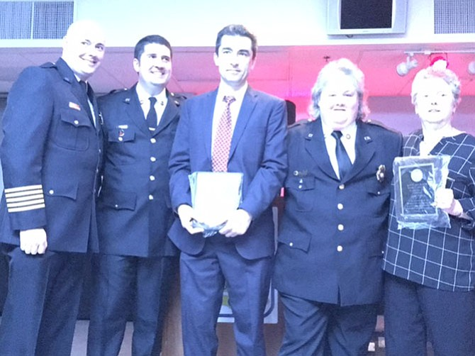 VVFD Chief John Morrison, VVFD president Anthony Stancampiano, and Auxiliary president Joanie Dempsey present the Kate Johnson Spirit Award to Valentin Neacsu, department member, and Jane Towle, Auxiliary member.
