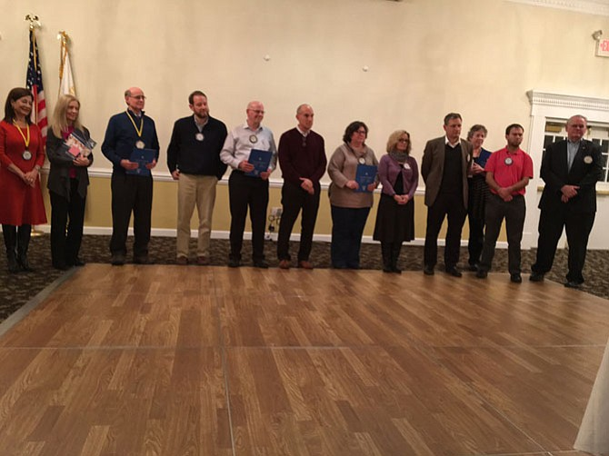 The Optimist Club of Greater-Vienna installed seven new members on Feb. 3. The members' sponsors accompanied them to their installation.