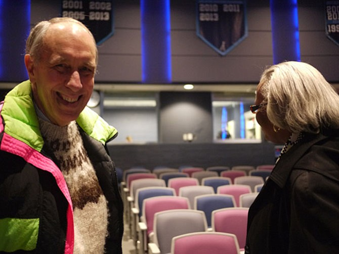 Bill Blaswell, chairman of the Neighborhood Conservation Advisory Committee, talks with Edith Gravely after the meeting.