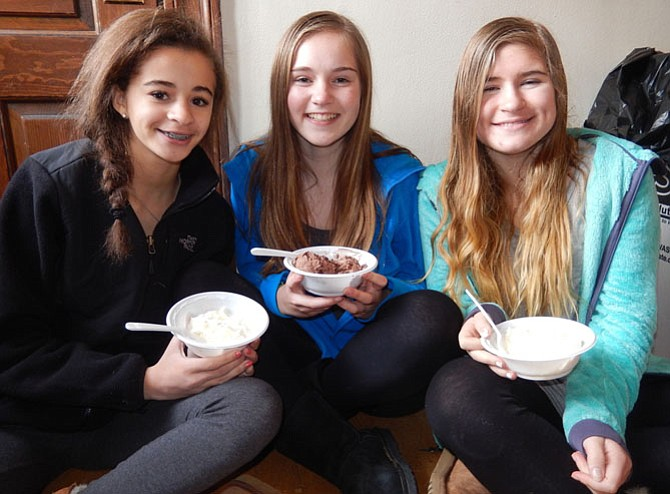 (From left) Eating ice cream together are (from left) high-school students Sela White, Abby Clouse and Mary Bruniany.