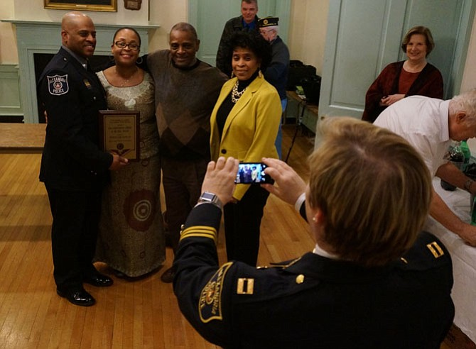 Officer Carl Stowe Jr., left, along with his wife Jamine and parents Carl Sr. and Roberta Stowe, smiles as Capt. Monica Lisle takes a photo following the presentation of the 2015 Law Enforcement Officer of the Year award Jan. 13 at American Legion Post 24.