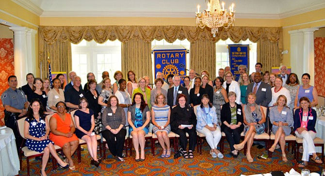 Representatives of 45 local nonprofits gather for a group photo last summer after being presented grants totaling more than $112,000 from the Rotary Club of Alexandria. Application deadline for the 2016 grants is Feb. 26.
