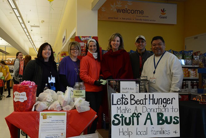 From left, Jennie Bush of Western Fairfax Christian Ministries, Giant Food employee Laura Fox, Julie Endersbee, U.S. Rep. Barbara Comstock (R-10), John Zarbo with Fairfax County Transit and Glenn Padeway, manager of Fairfax County Human Services Transportation, gather at a food donation site in the Clifton Giant Food on Feb. 6.