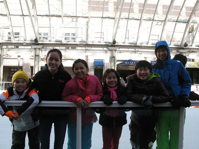 "Family members, from right, Kingston Ho, Vivian Cao-Dao, Kathleen Pham, Alice Cao-Dao, Brian Dao and Danny Pham skate together. ""It's a good place to meet and hang out,"" Vivian Cao-Dao said. ""Even if you're a beginner, it's OK, because everyone falls."""
