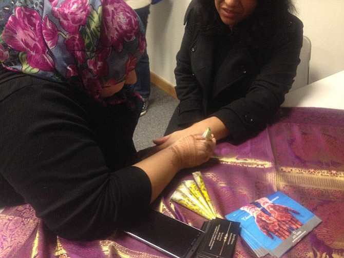 Henna hand artist Shazia Jalil attended A Taste of the Arab World event at Reston Hunters Woods Friday, Feb. 12. Reston Community Center brings the community together through enriching time experiences.