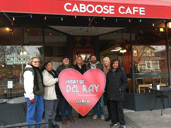 Rhoda Worku, right, owner of the Caboose Café and winner of the 2016 Heart of Del Ray award, is joined for a photo by past winner Pat Miller, Caboose Café employee Iris Hasing, and past winners Serdar Basegmez, Bobi Bomar, Eric Reid and Megan Brown.