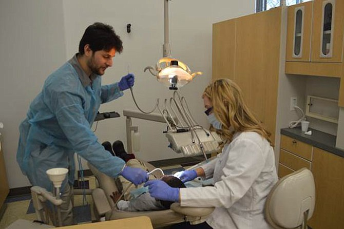 NOVA MEC students perform dental services during the Give Kids a Smile event on Friday, Feb. 5.