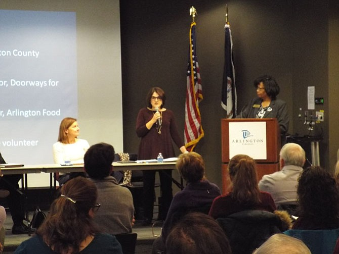 Wanda Pierce, executive director of Arlington Community Foundation, at podium moderating panelists Anita Friedman, director of Arlington County Department of Human Services (standing with microphone), and Caroline Jones, executive director of Doorways for Women and Families.