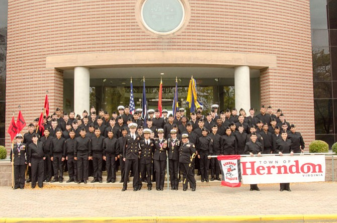 Maxwell (front center) celebrates with Herndon Navy JROTC cadets after the October 2015 Herndon Homecoming Parade.