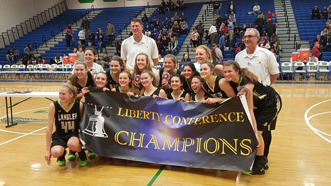 The Langley girls' basketball team on Feb. 20 won its first conference/district championship since 1988.
